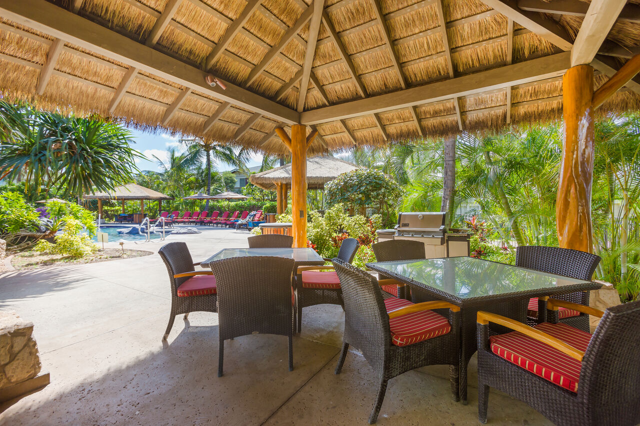 Picture of Outdoor Chairs and Tables by the Pool in our Ko Olina Kai Golf Estates.