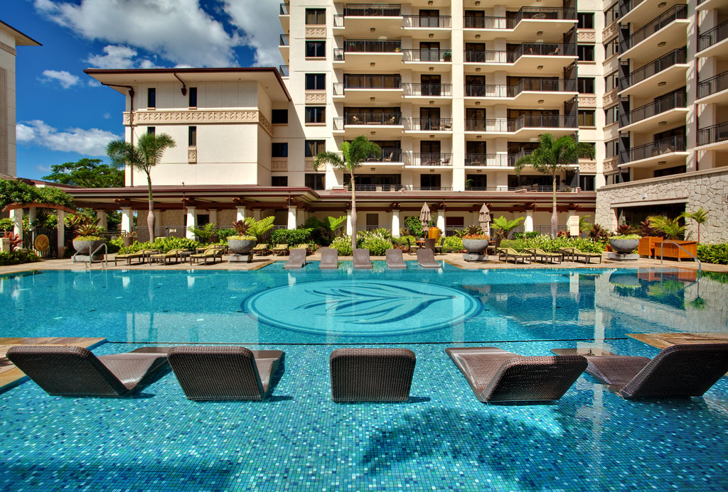 Picture of the Pool with Lounge Chairs in our Hawaii Beach Villa Rentals.